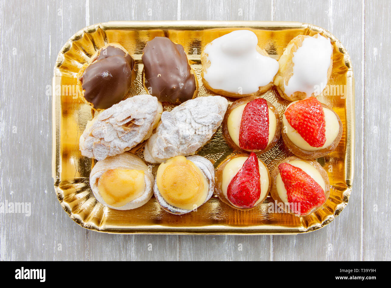 Tray of assorted cakes - Stock Image