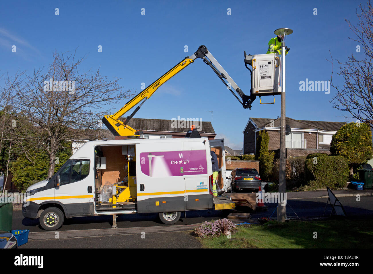 Fitting Energy efficient LED Lights in Edinburgh Stock Photo