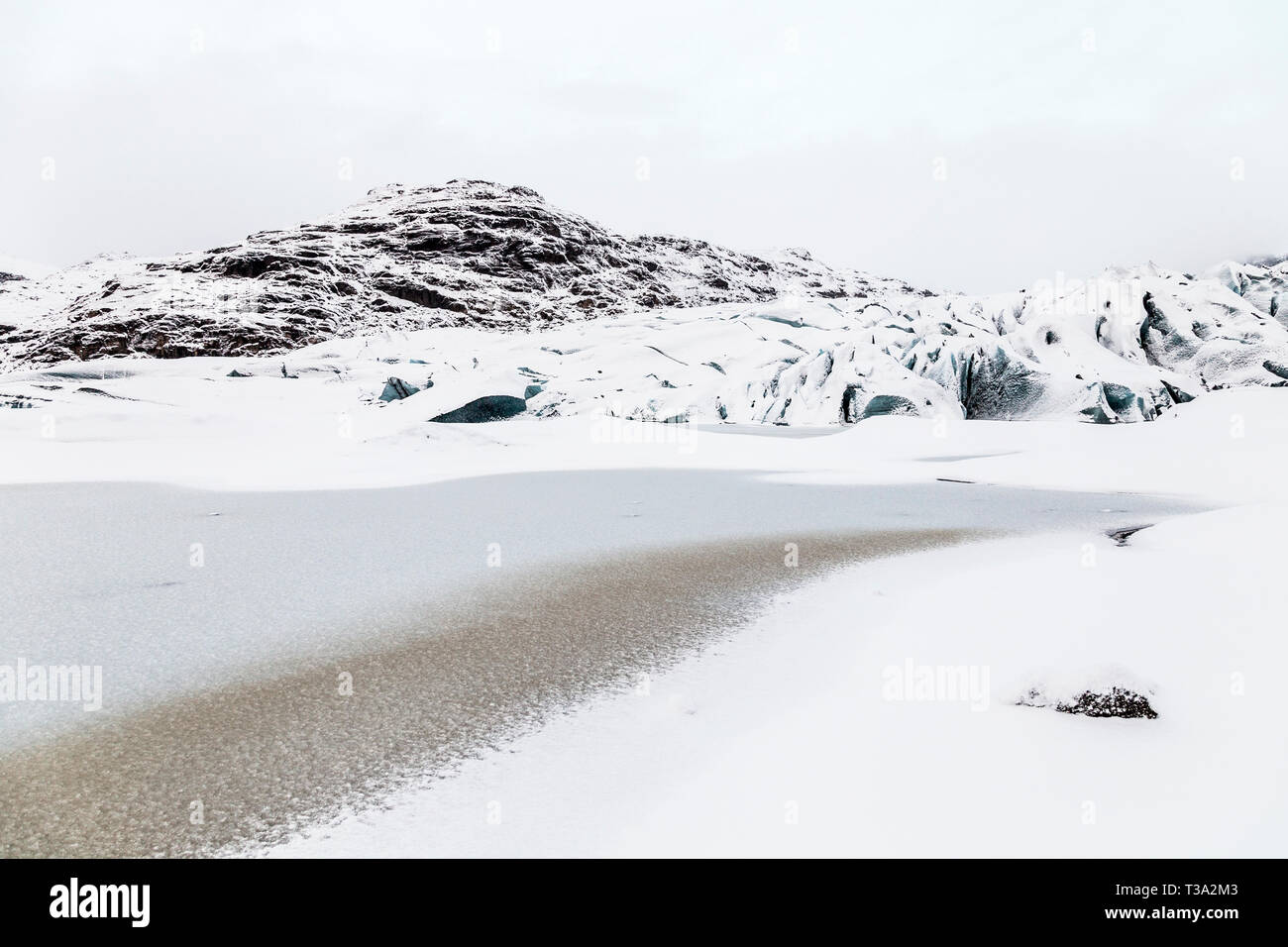 Solheimajokull Glacier covered with snow, Iceland - Stock Image
