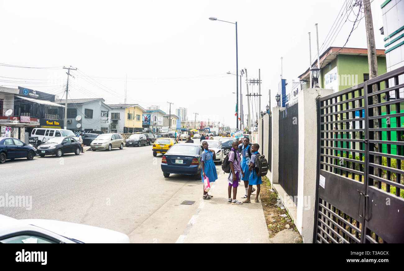 Lagos Nigeria February 15 2019 - A busy afternoon on Bode Thomas Street surulere - with vehicles, buildings and people - Stock Image