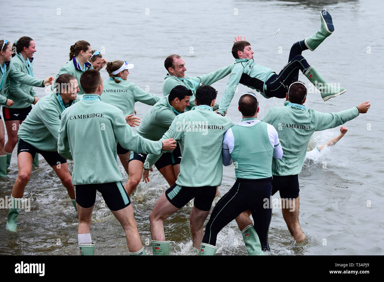 London, UK. 7th Apr, 2019. Cambridge University men's crew throw their cox Matthew Holland into the water after winning the men's boat race between Oxford University and Cambridge University on the River Thames in London on April 7, 2019. Credit: Stephen Chung/Xinhua/Alamy Live News Stock Photo