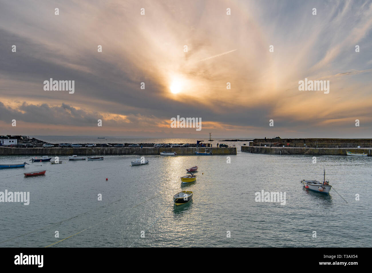Mousehole, Cornwall, UK. 8th April 2019. UK Weather. The sun just starting to break through the low clouds this morning at Mousehole, for the first week of the Easter holidays. Credit: Simon Maycock/Alamy Live News Stock Photo