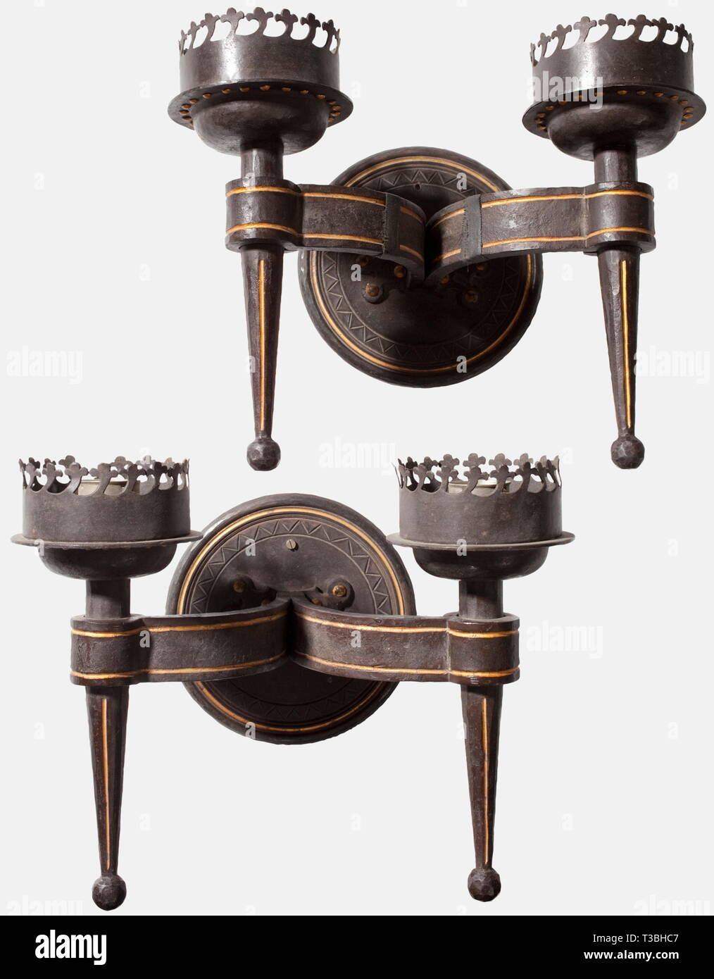 A pair of wrought iron wall sconces, from the Berchtesgadener Hof Double lamp versions, the surfaces with traces of the forging process, darkly patinated and decorated with gilt ornamental lines, complete with wall holder, newly electrified, the lampshades are missing. Height 28.5 cm. Cf. Florian M. Beierl, History of the Berchtesgadener Hof, Berchtesgaden 1991, p. 30, upper fig. The Berchtesgadener Hof had been built as a grand hotel in 1898 and provided accommodation especially for Kaiser Wilhelm II., his family as well as domestic and foreign aristocracy. In 1939 the NSD, Editorial-Use-Only - Stock Image