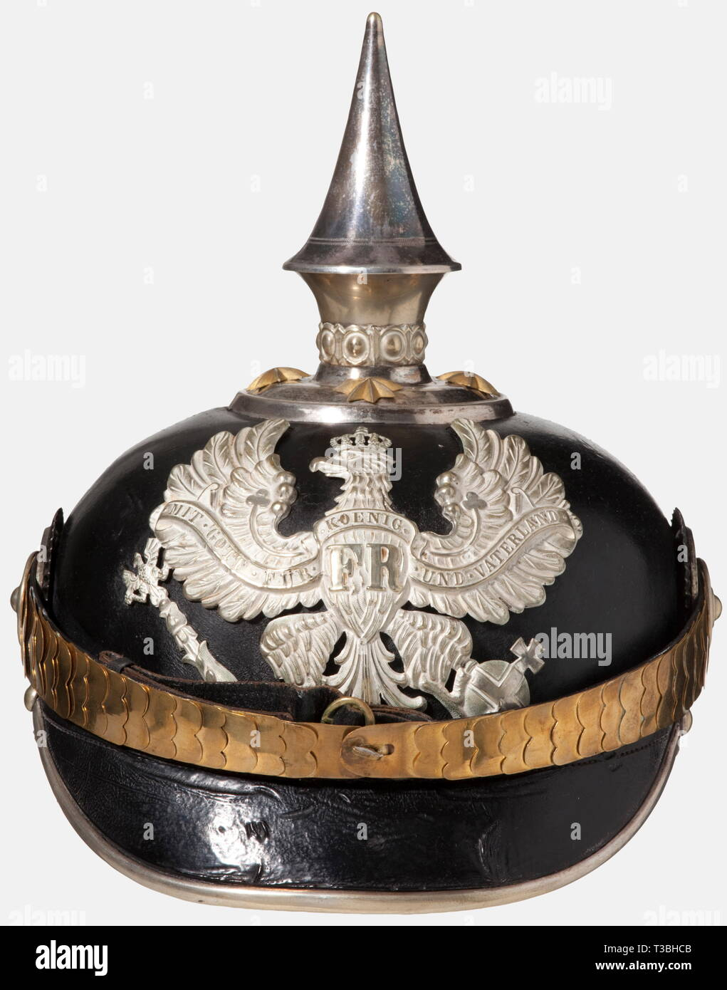 A helmet for officers, of the Prussian Line Pioneer Battalions Black-lacquered fiber body, silver-plated mountings. Line unit eagle. Gilded star screws and flat metal chinscales. Officer's cockades. Beige-coloured ribbed silk lining, torn. Good overall condition, signs of age and wear. historic, historical, 19th century, Prussian, Prussia, German, Germany, militaria, military, object, objects, stills, clipping, clippings, cut out, cut-out, cut-outs, helmet, helmets, headpiece, headpieces, utensil, piece of equipment, utensils, protection, headgea, Additional-Rights-Clearance-Info-Not-Available - Stock Image