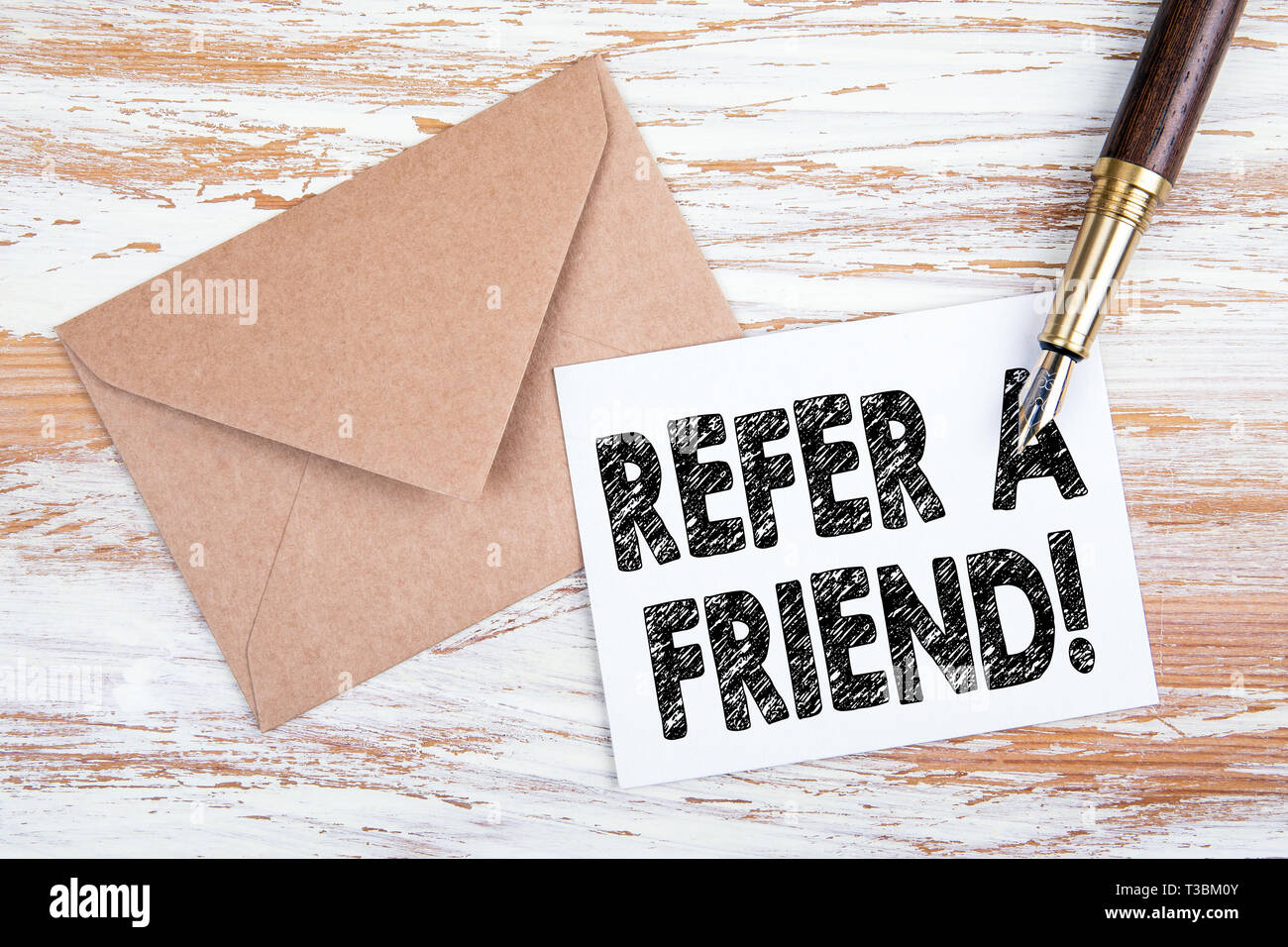 Refer a friend. Paper letter and pen - Stock Image