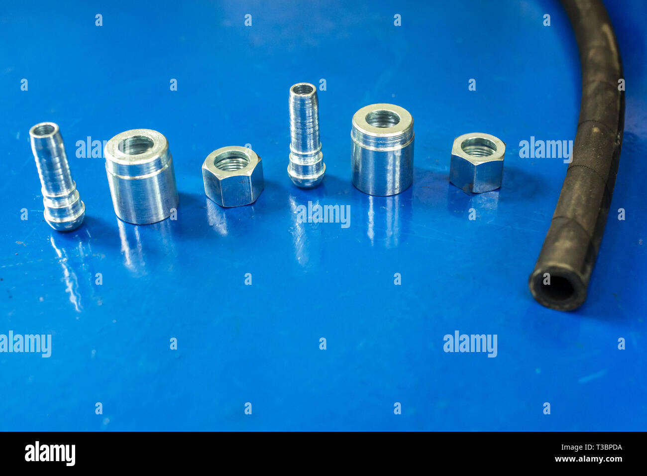 aluminum disassembled parts of high pressure hose with fittings - Stock Image
