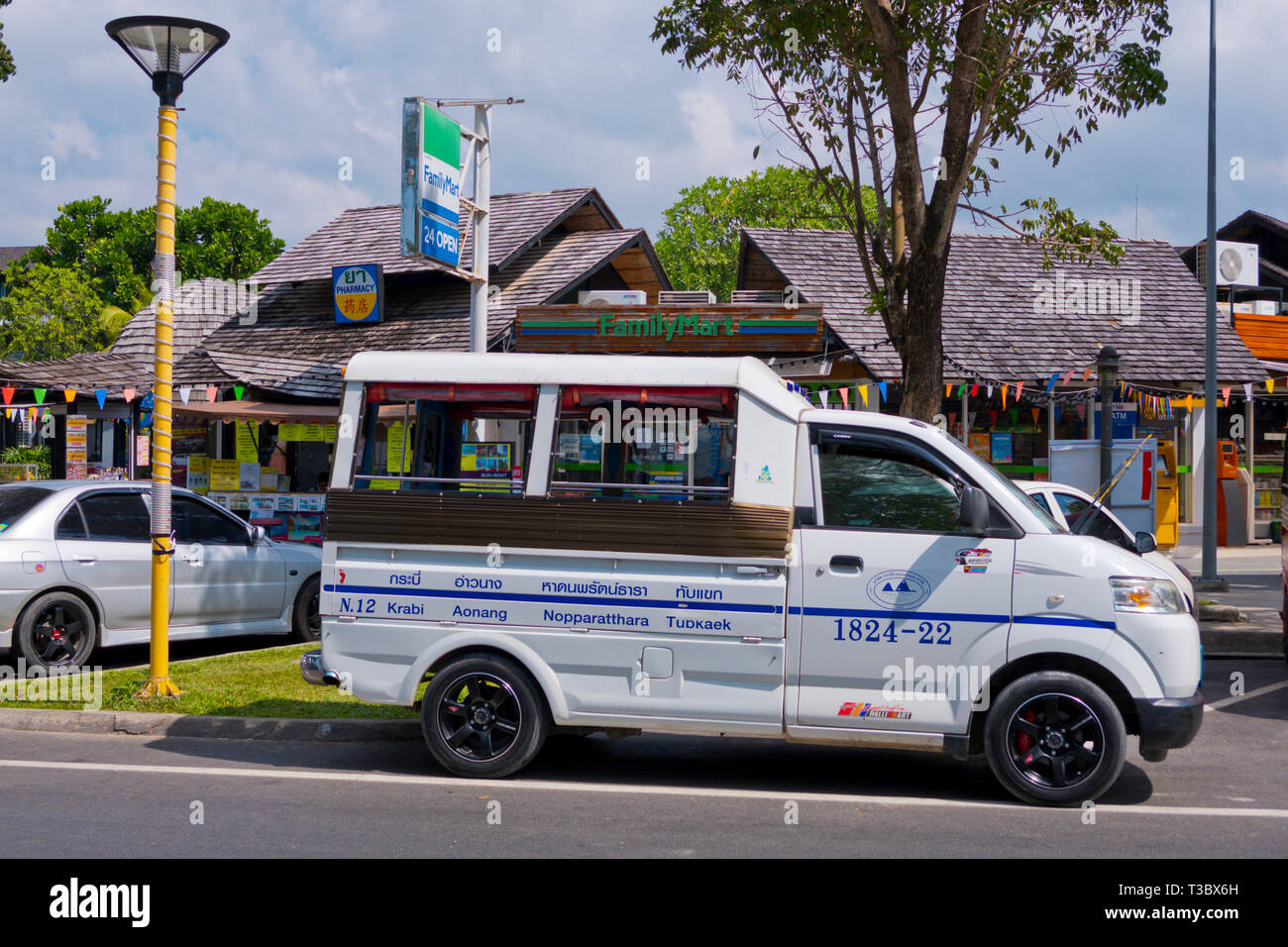 Songthaew, share bus, Beach road, Road 4203, Hat Noppharat Thara, Krabi province, Thailand - Stock Image