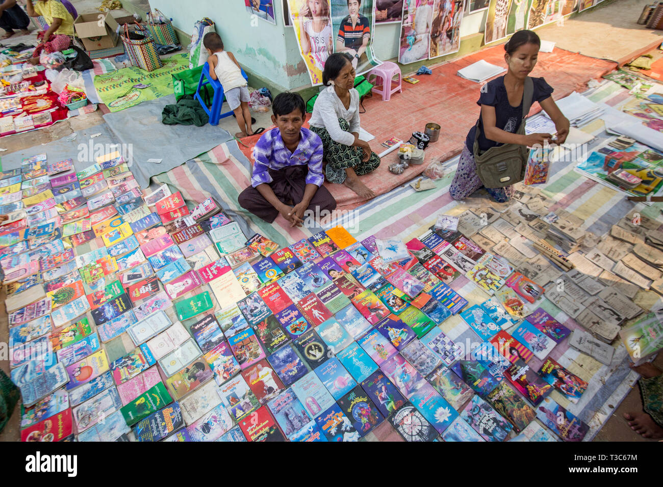 Book seller at the Vesak full moon festival to celebrate the birthday of Lord Buddha at Shwe Yin Maw Pagoda, near Thazi, Myanmar (Burma). - Stock Image