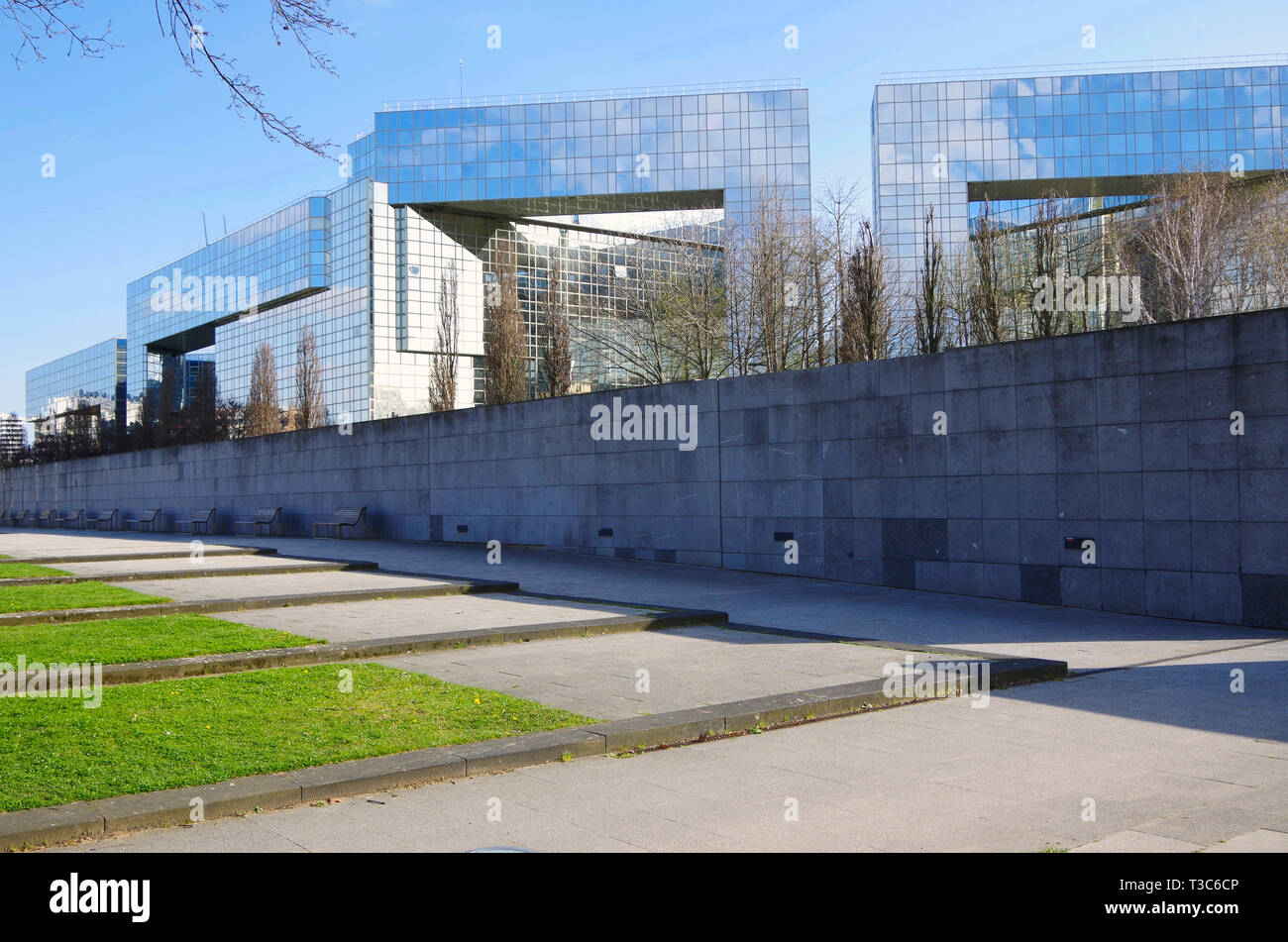 Buildings for various government offices, all clad in reflective glass, overlooking the Parc André Citroen, which they do nothing to enhance. Stock Photo