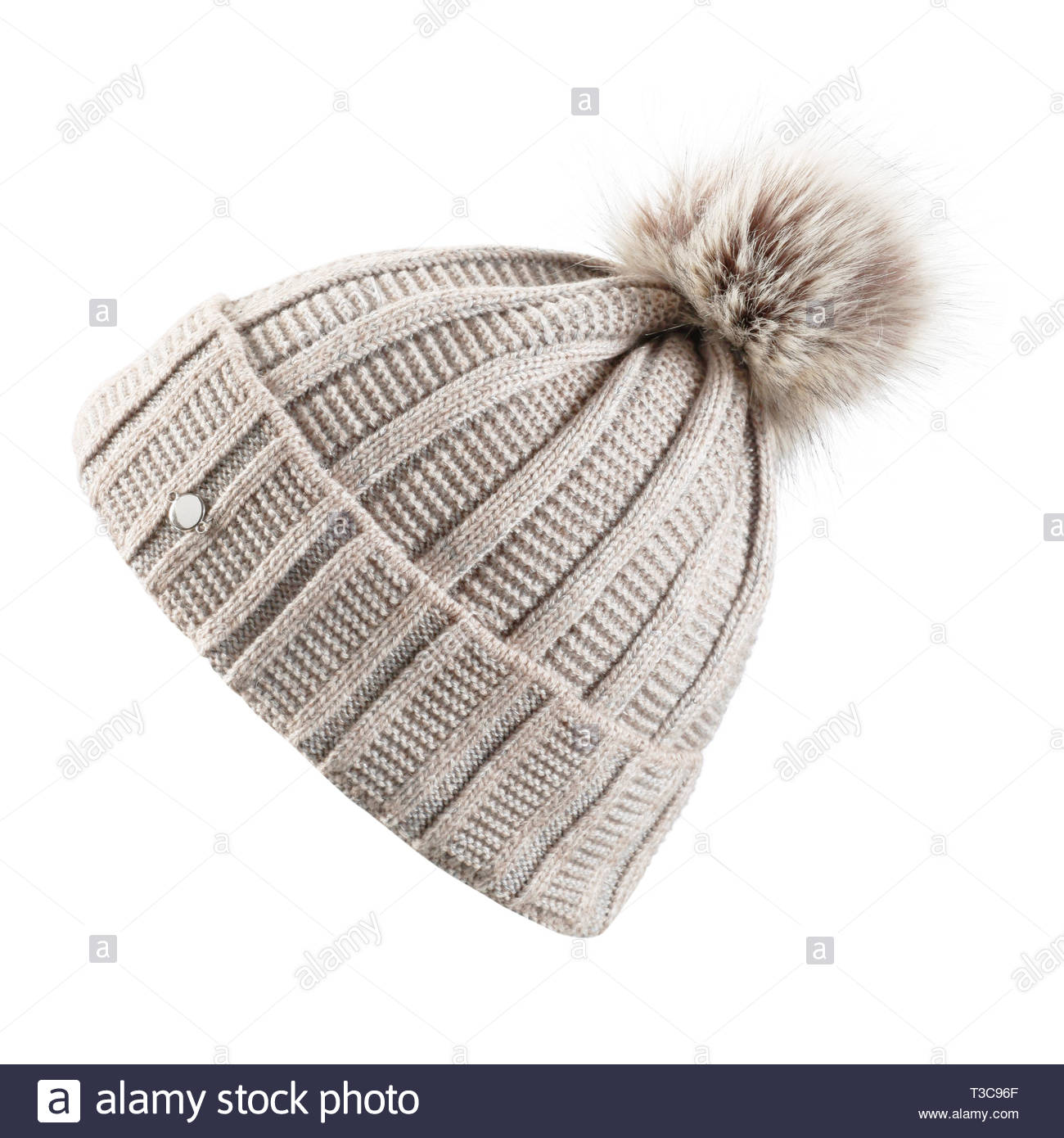 Beige Knitted Hat with a Faux Fur Pompom Isolated on White Background. Ladies Cream Wool Knit Ski Beanie. Outdoors Casual Winter Two Tone Hat Knitting - Stock Image