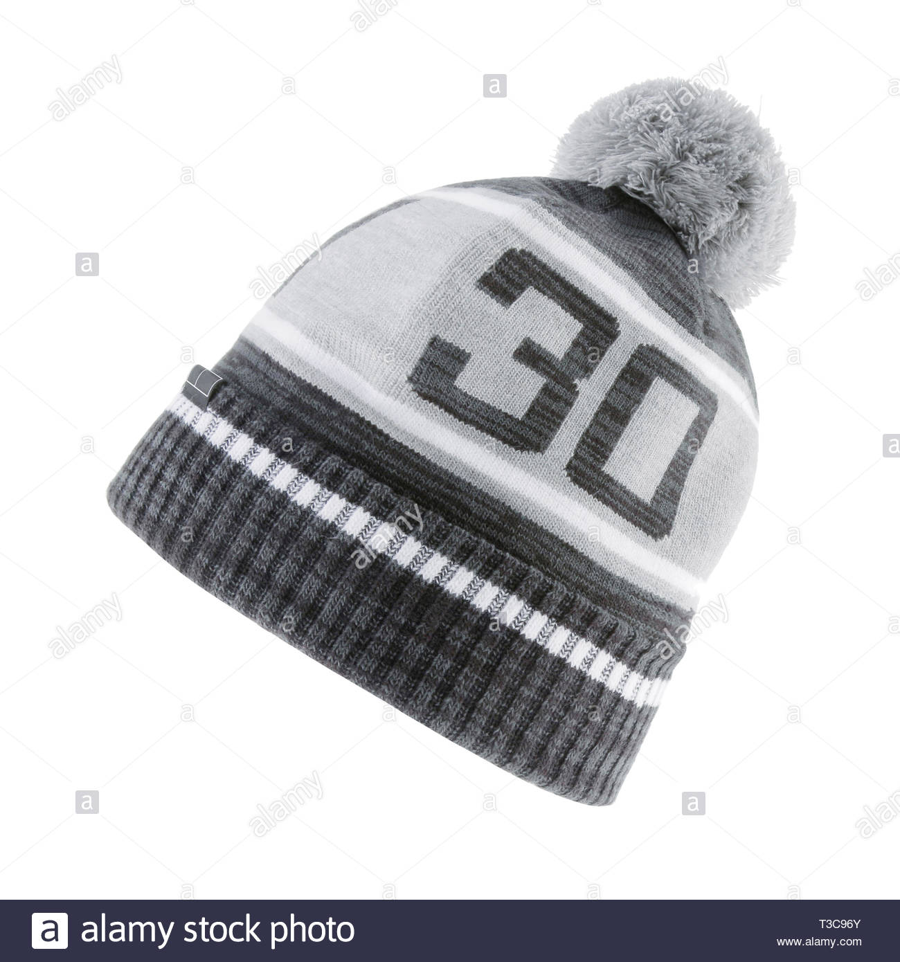 Black and Heather Gray Ski Knitted Hat with a Faux Fur Pompom Isolated on White Background. Outdoors Casual Two-Tone Knit Bobble Hat with Pattern and  - Stock Image