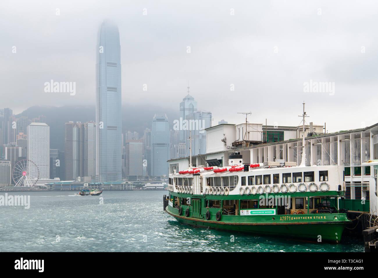 Star Ferry, Hong Kong. Ferry at Kowloon Ferry Terminal looking towards Two International Finance Centre on Hong Kong Island, Tsim Sha Tsui, Hong Kong Stock Photo