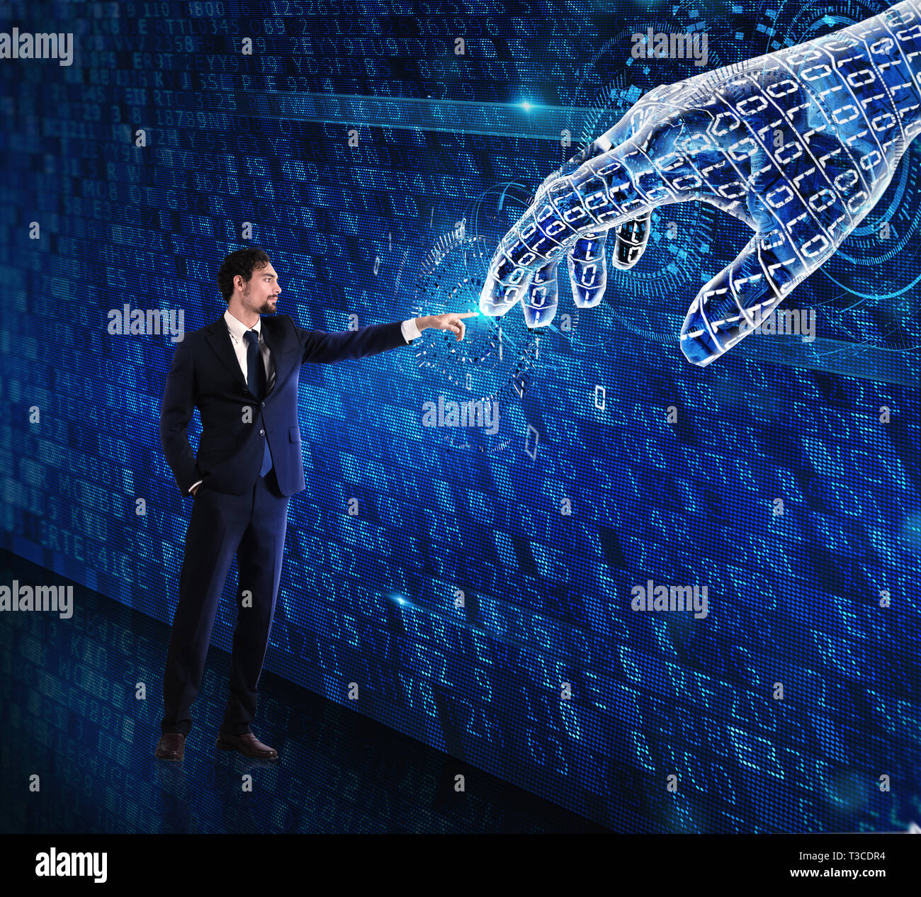 Man machine interaction between human and a digital hand - Stock Image