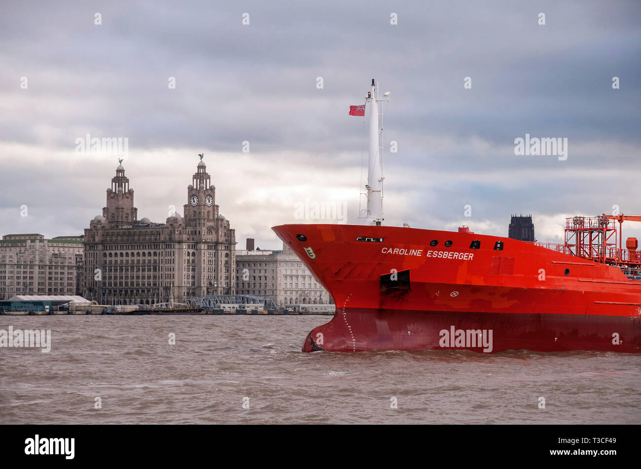 The oil and chemical tanker ship the Caroline Essberger from Holland in the river Mersey. The Royal Liver building in the background. - Stock Image