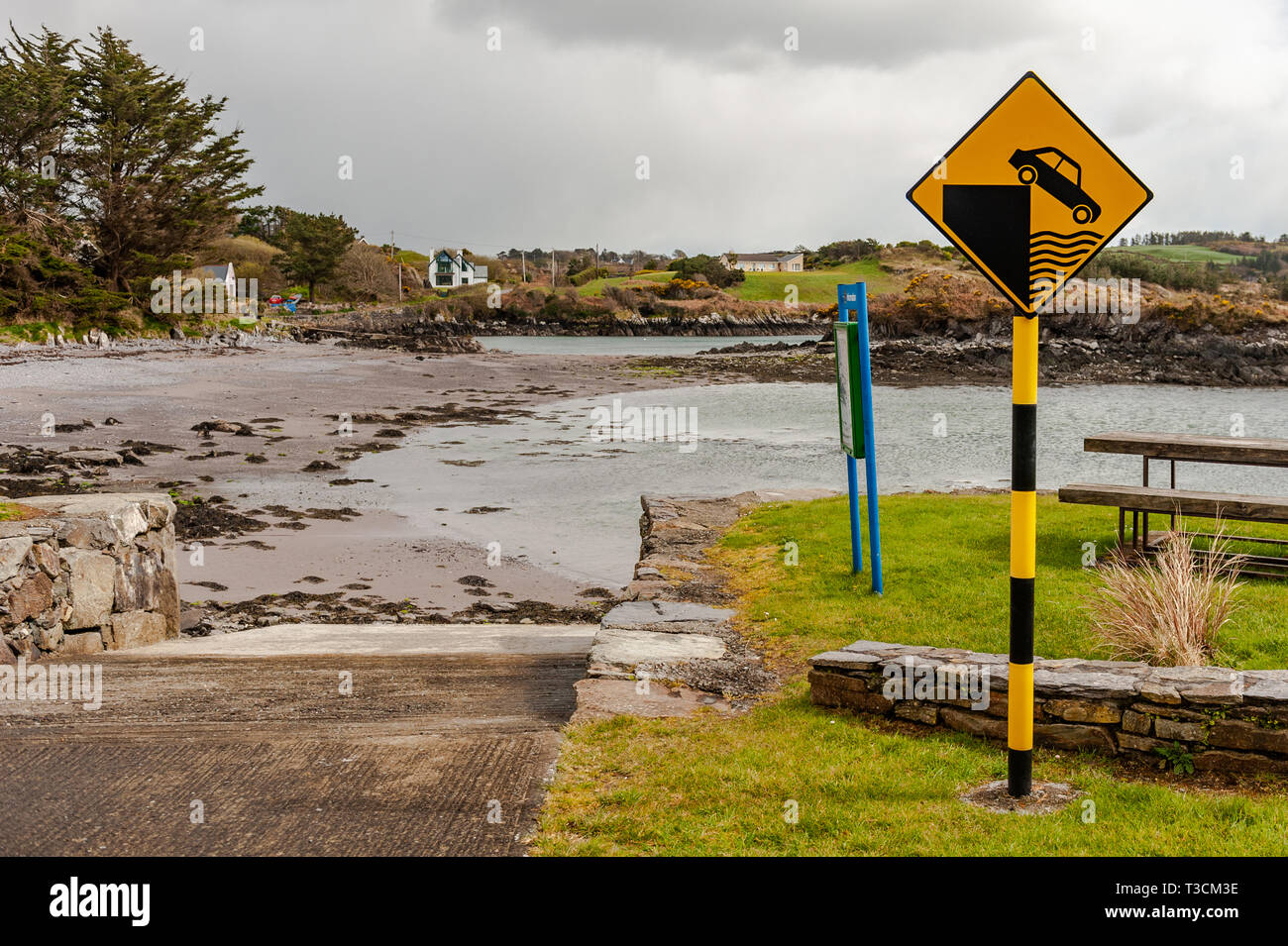 Unprotected Quay road sign in Schull, West Cork, Ireland. - Stock Image