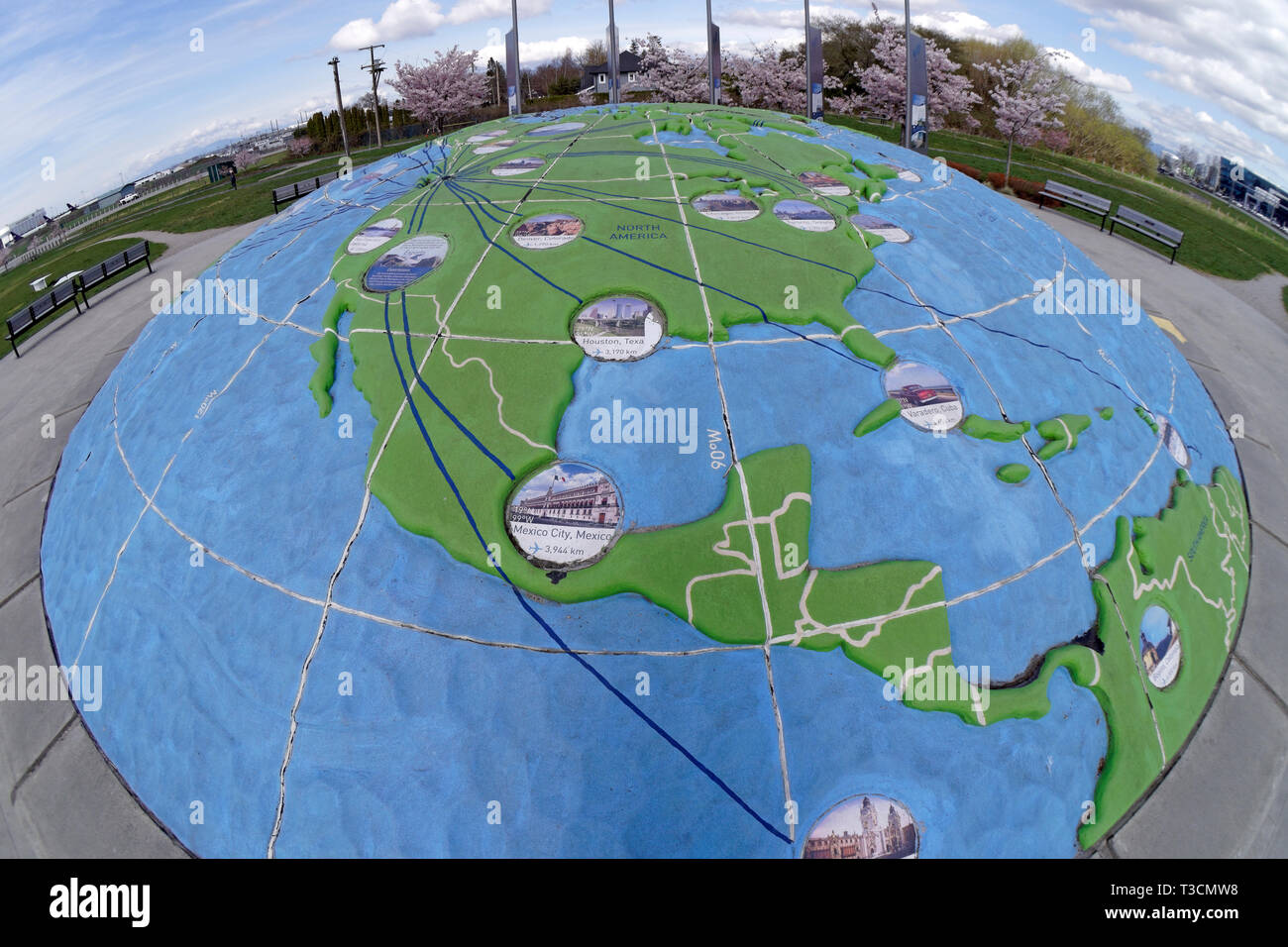 Fsheye view of three dimensional map of the world showing the Americas  in Larry Berg Flight Path Park, Richmond, BC, Canada Stock Photo