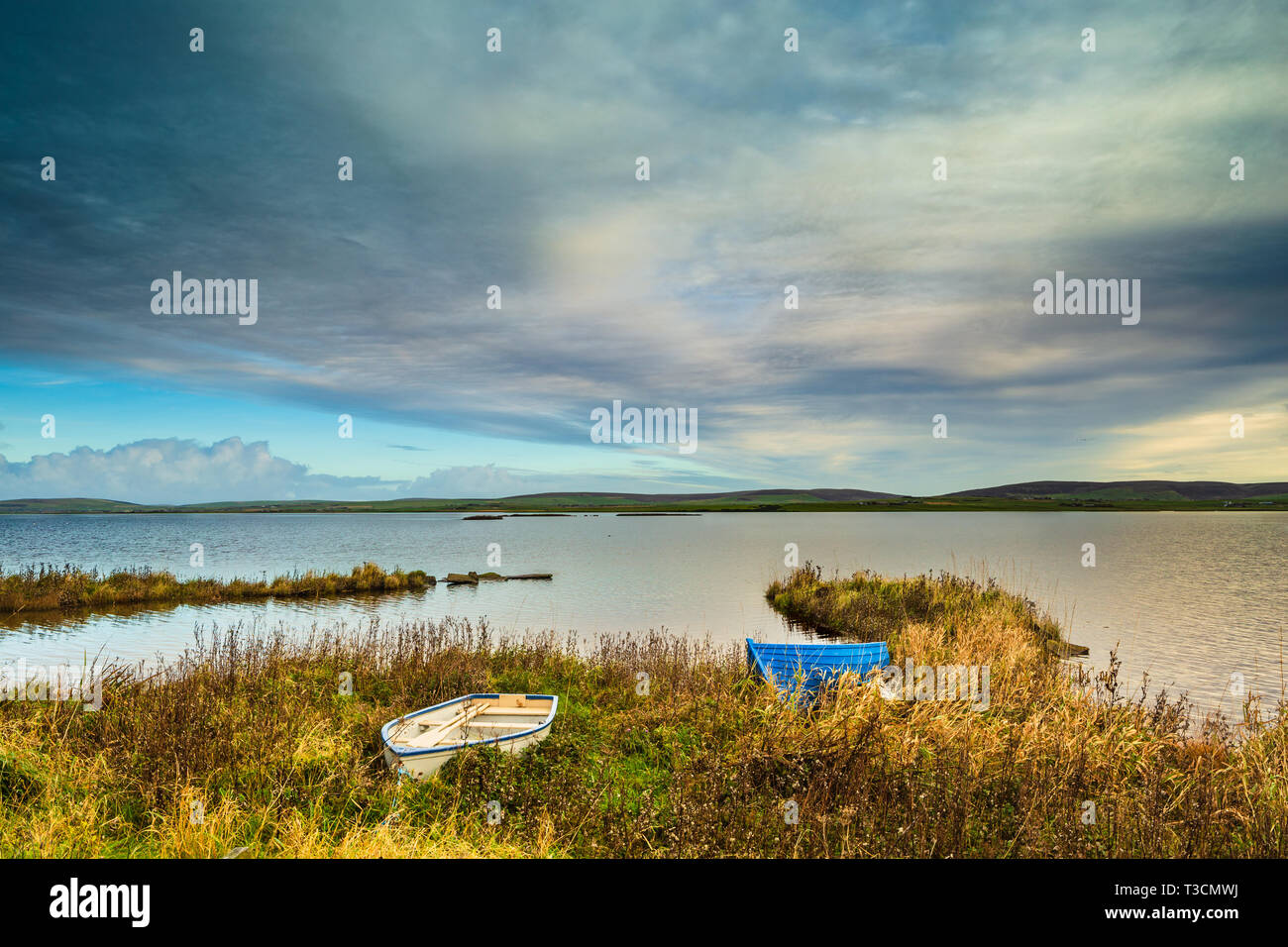 Boats pulled up at the side of the Loch of Harray, Mainland, Orkney Islands. Stock Photo