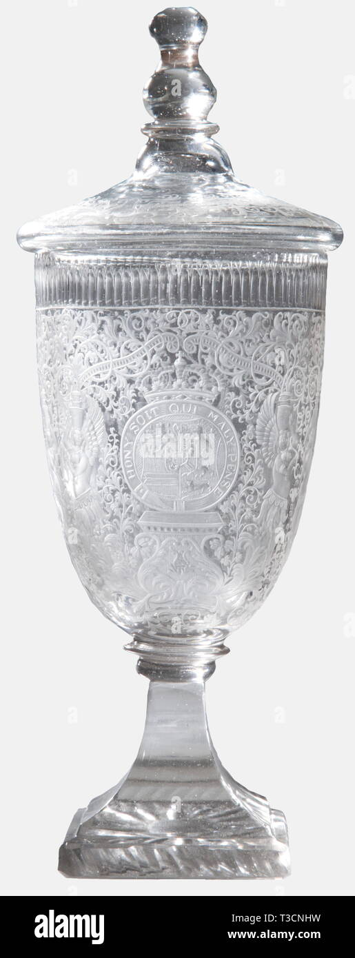 Prince William V Batavus of Orange (1748 - 1806), a lidded goblet with the coat of arms for the Netherlands Stadtholder Silesian work around 1780/90. Colourless cut glass, both clear and matt, the bell-shaped cup is excessively decorated. The front displays the Prince's crowned coat of arms within the ribbon of the Most Noble Order of the Garter, surrounded by fine vine work with mytholocical creatures and allegorical figures. Quadrangular base with prisms and stars cut into the bottom. The lid is decorated en suite and has a facetted, round fini, Additional-Rights-Clearance-Info-Not-Available - Stock Image