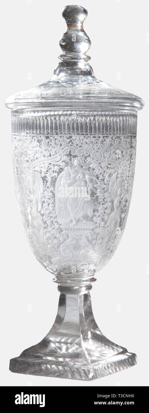 Prince William V Batavus of Orange (1748 - 1806), a lidded goblet with the coat of arms for the Netherlands Stadtholder Silesian work around 1780/90. Colourless cut glass, both clear and matt, the bell-shaped cup is excessively decorated. The front displays the Prince's crowned coat of arms within the ribbon of the Most Noble Order of the Garter, surrounded by fine vine work with mytholocical creatures and allegorical figures. Quadrangular base with prisms and stars cut into the bottom. The lid is decorated en suite and has a facetted, round fini, Additional-Rights-Clearance-Info-Not-Available Stock Photo