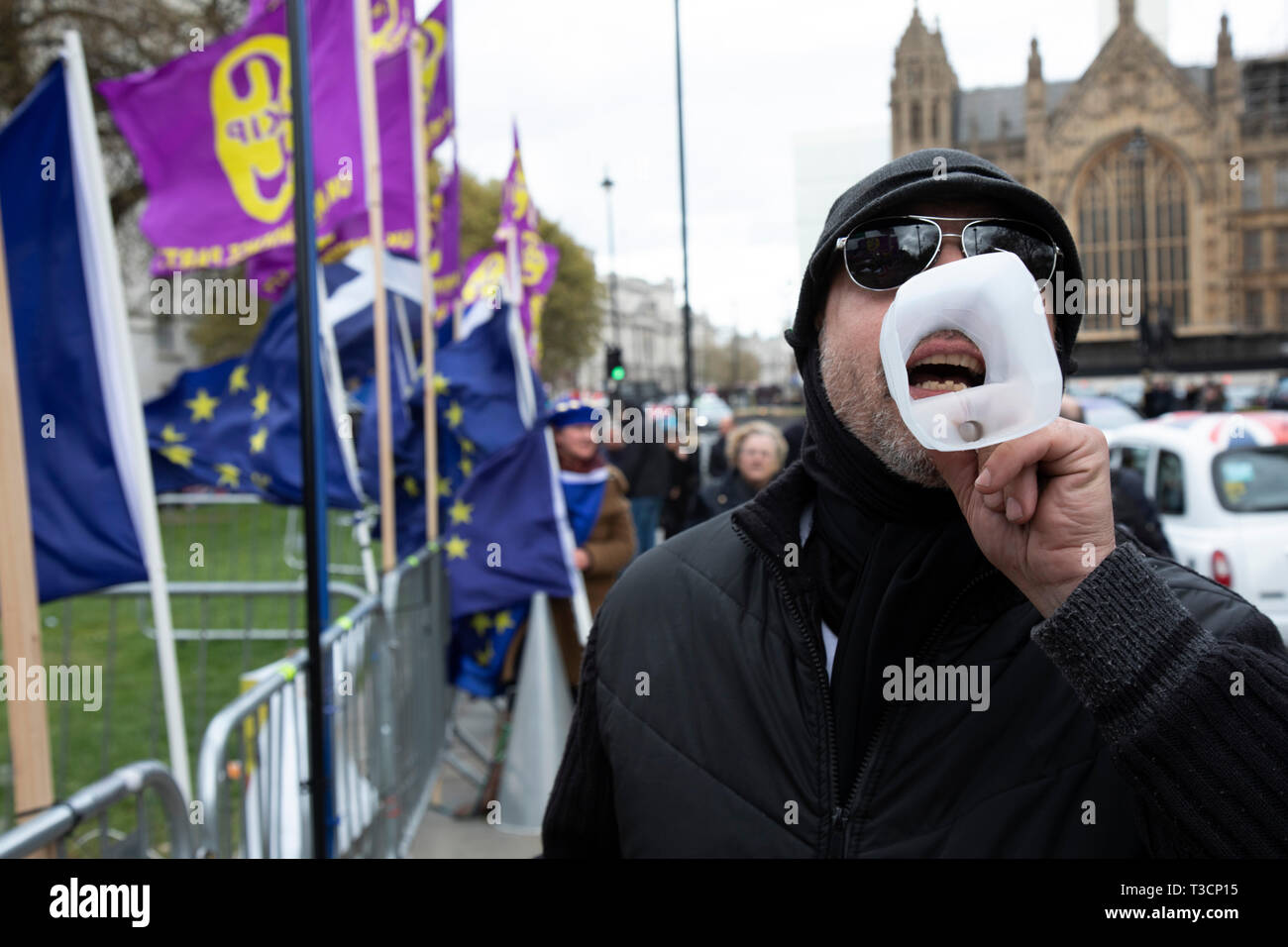 Anti Brexit, protester using a milk carton as a loud hailer in Westminster as the leader of the opposition and the Prime Minister continue talks to solve the Brexit Withdrawal Agreement on 4th April 2019 in London, England, United Kingdom. With just over two weeks until the UK is supposed to be leaving the European Union, the final result still hangs in the balance. - Stock Image