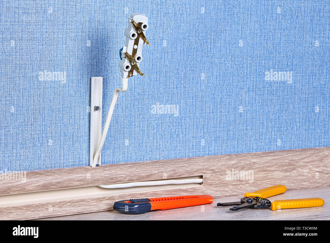 installing of electric plug house wiring with hand tools on the floor