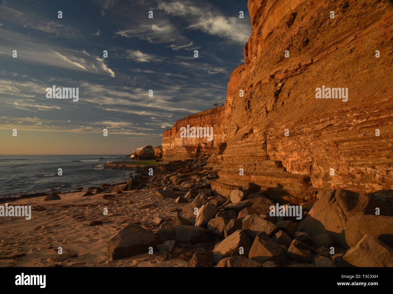 Waves from Pacific Ocean crashing on rocky shoreline along famous Sunset Cliffs, Point Loma, San Diego, CA, USA Stock Photo