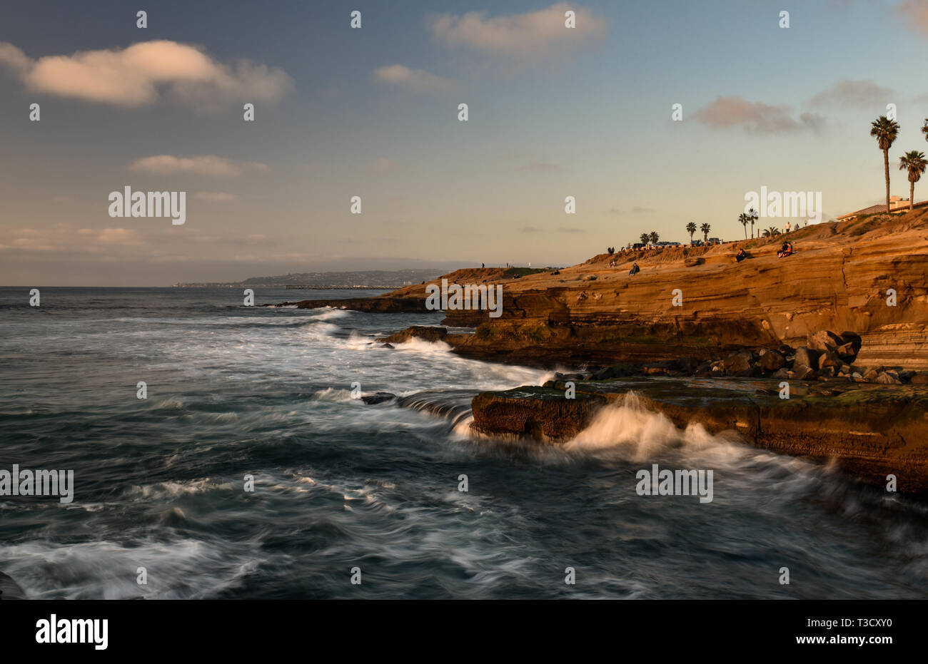 Waves from Pacific Ocean crashing on rocky shoreline along famous Sunset Cliffs Natural Park, Point Loma, San Diego, CA, USA Stock Photo