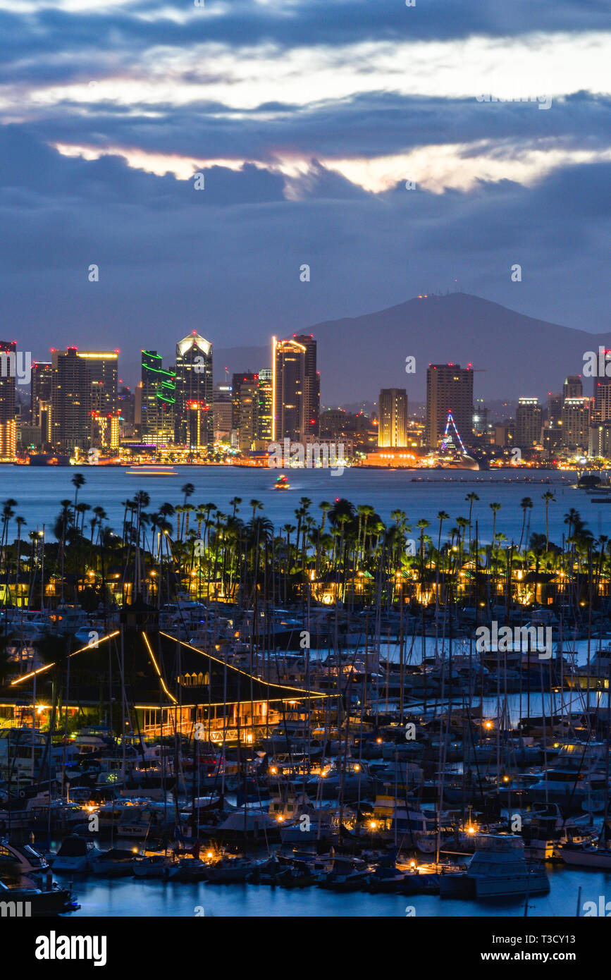 Calm sunrise, pre-dawn, over the San Diego skyline, with North San Diego Bay and docked sailboats off Shelter Island, California, USA Stock Photo