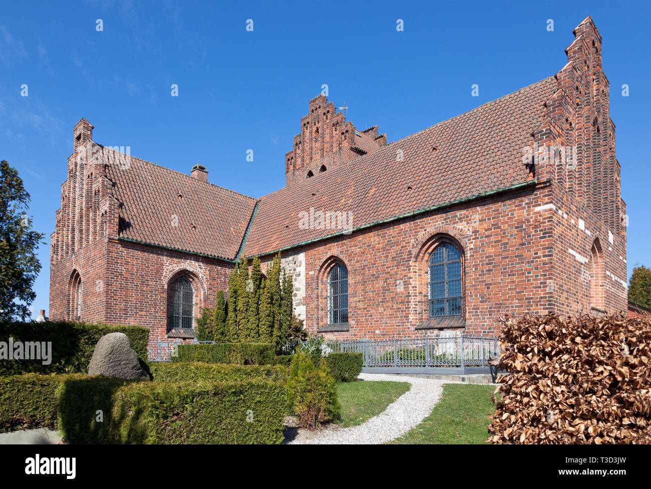 Lyngby Church in Romanesque style originally from mid 12th century. Lengthened in  Late Gothic era. Kongens Lyngby, a northern suburb to Copenhagen. - Stock Image