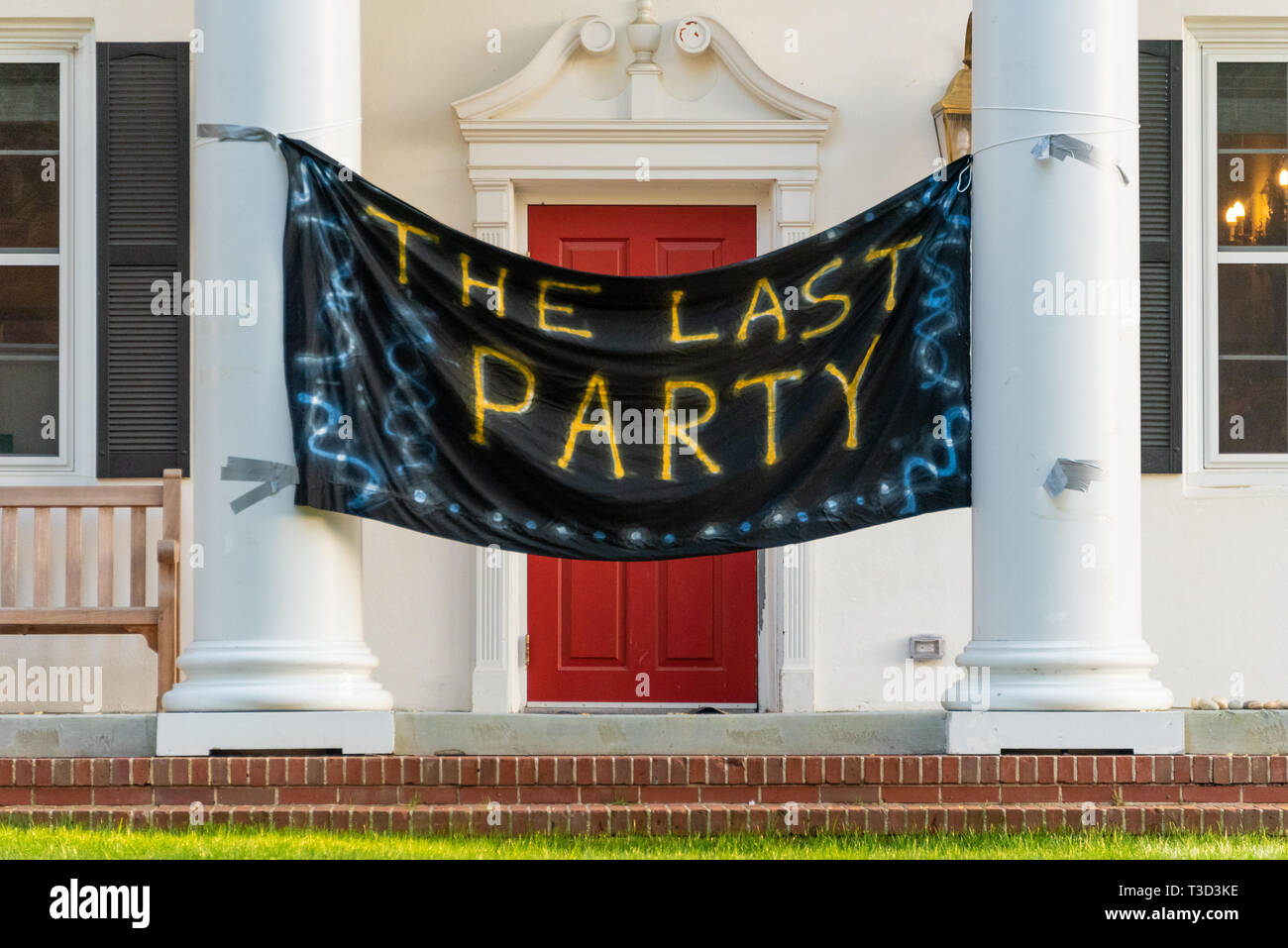 'The Last Party' banner hangs between the front columns of a fraternity house on the campus of Emory University shortly before college graduation. - Stock Image