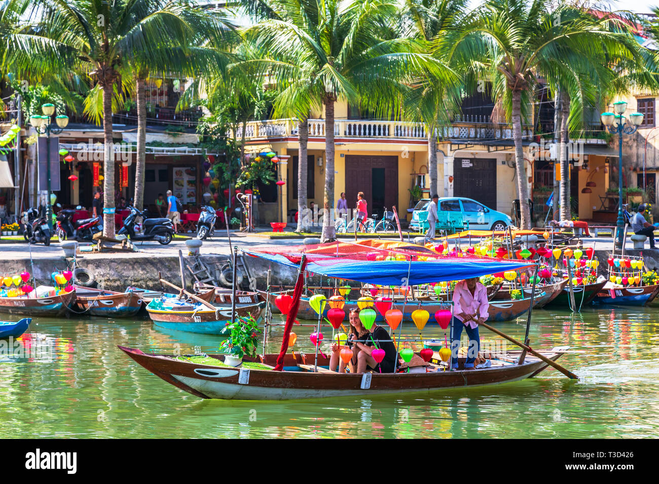 Tourists being taken for a sail on a lantern boat along the River Son Thu Bon, at Hoi An, Quang Nam Provence, Vietnam, Asia. Stock Photo