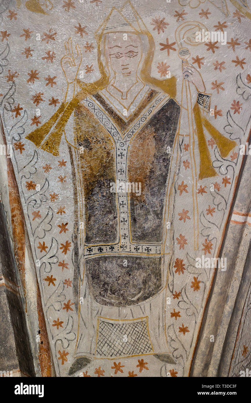 Archbishop holds a crook in his left hand and blesses with his right. Fresco in Fjelie church, Sweden, Feb 06, 2015, - Stock Image