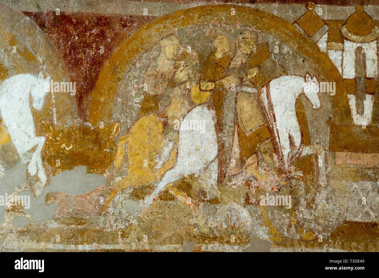 Two templars on a horse, riding towards the holy grail. The last templar is holding a church model? Medieval mural in Skibet church, October 27, 2015 - Stock Image