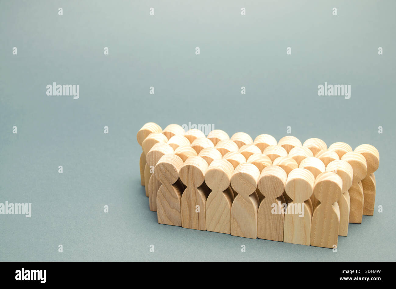 The crowd of wooden figures of people. Concept of business team. Labor collective. Teamwork. Employees. Human Resource Management. Labor market. Demog - Stock Image