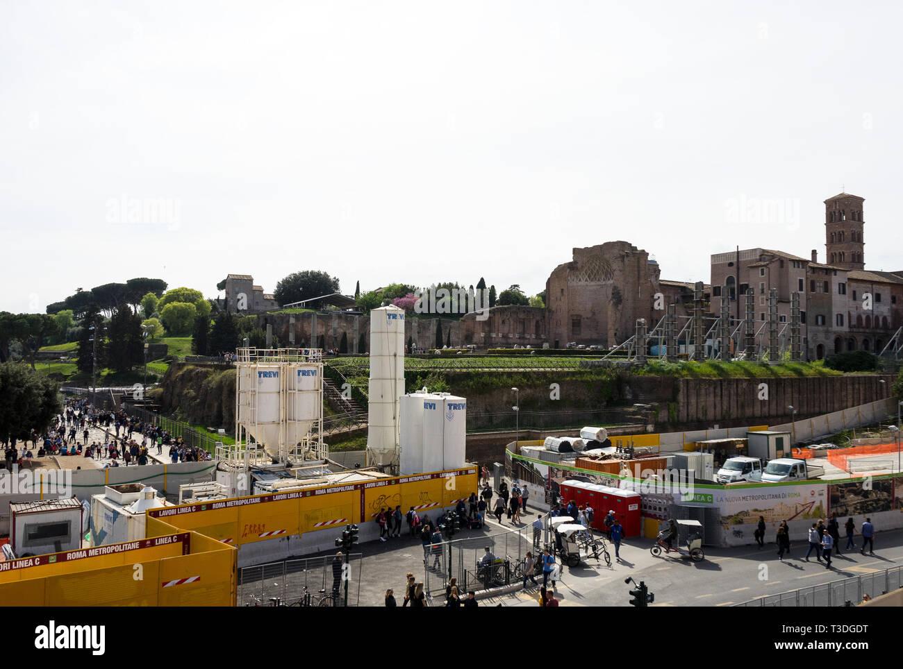 Colosseum, Rome, Italy 04/06/2019: new metro line c building, Fori Imperiali Station. In the background Basilica of Santa Francesca Romana - Stock Image