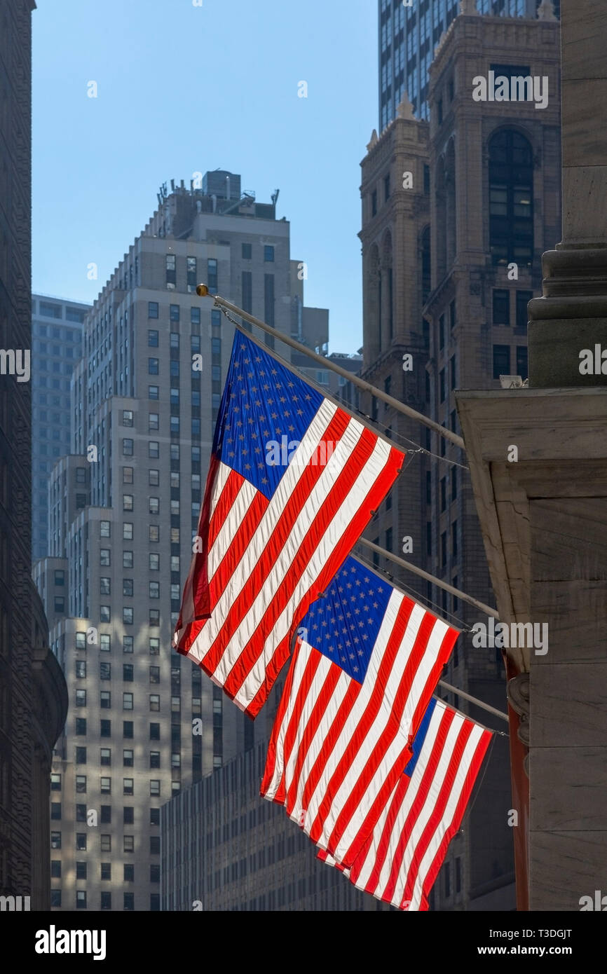 Three American flags flying outside the New York Stock Exchange, New York, New York State, United States of America. - Stock Image