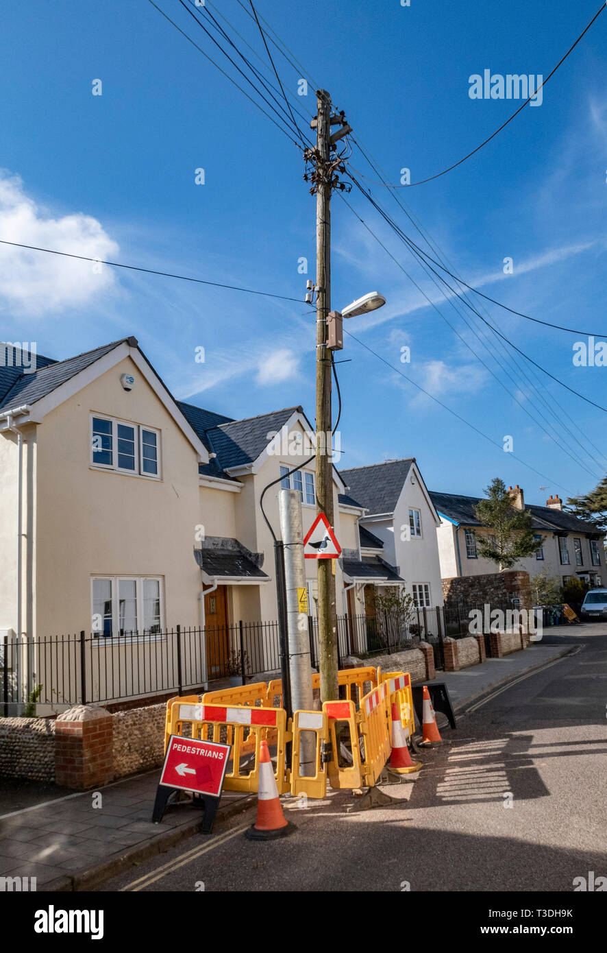 Work to replace telegraph telephone poles masts in Mill Street, Sidmouth, Devon, UK Stock Photo