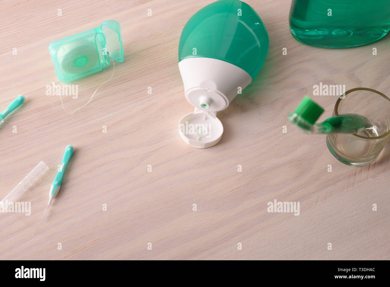 Tools for oral hygiene on wooden table. Horizontal composition. Front view. - Stock Image