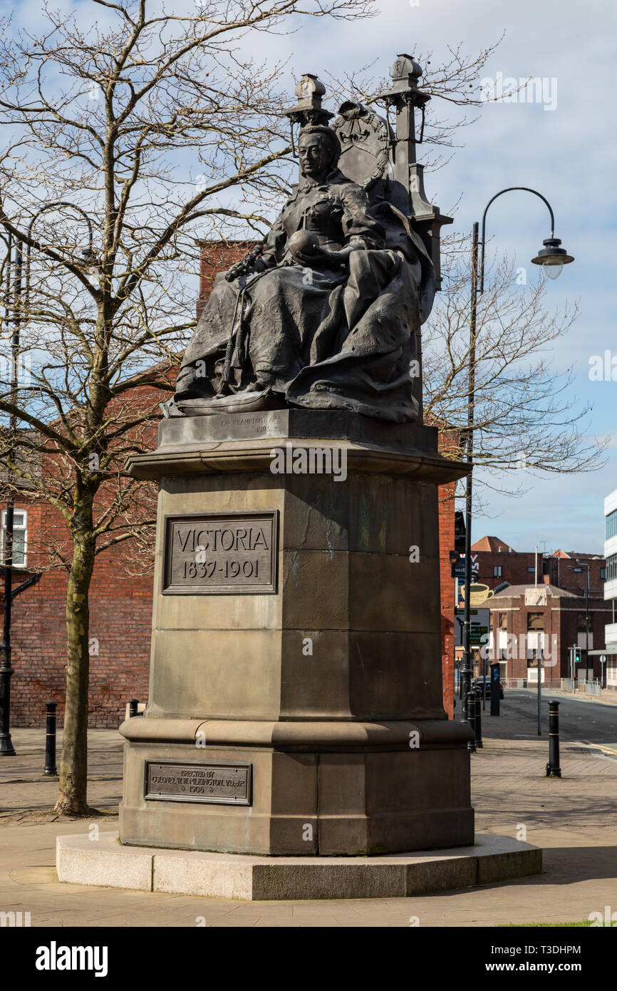 Statue of Queen Victoria on a throne St Helens Merseyside England March 2019 Stock Photo