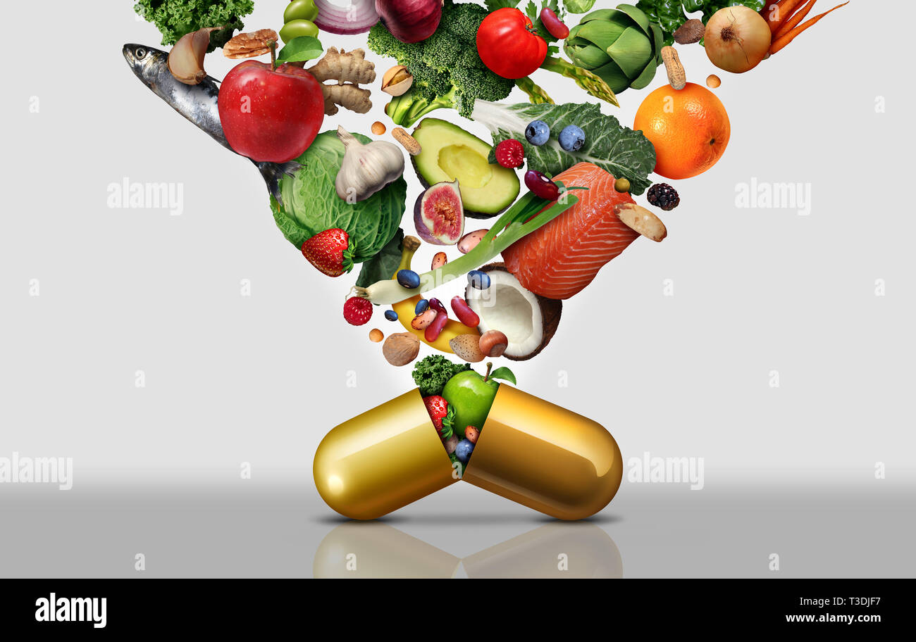 Vitamin dietary supplement as a capsule with fruit vegetables nuts and beans inside a nutrient pill as a natural medicine health treatment. - Stock Image