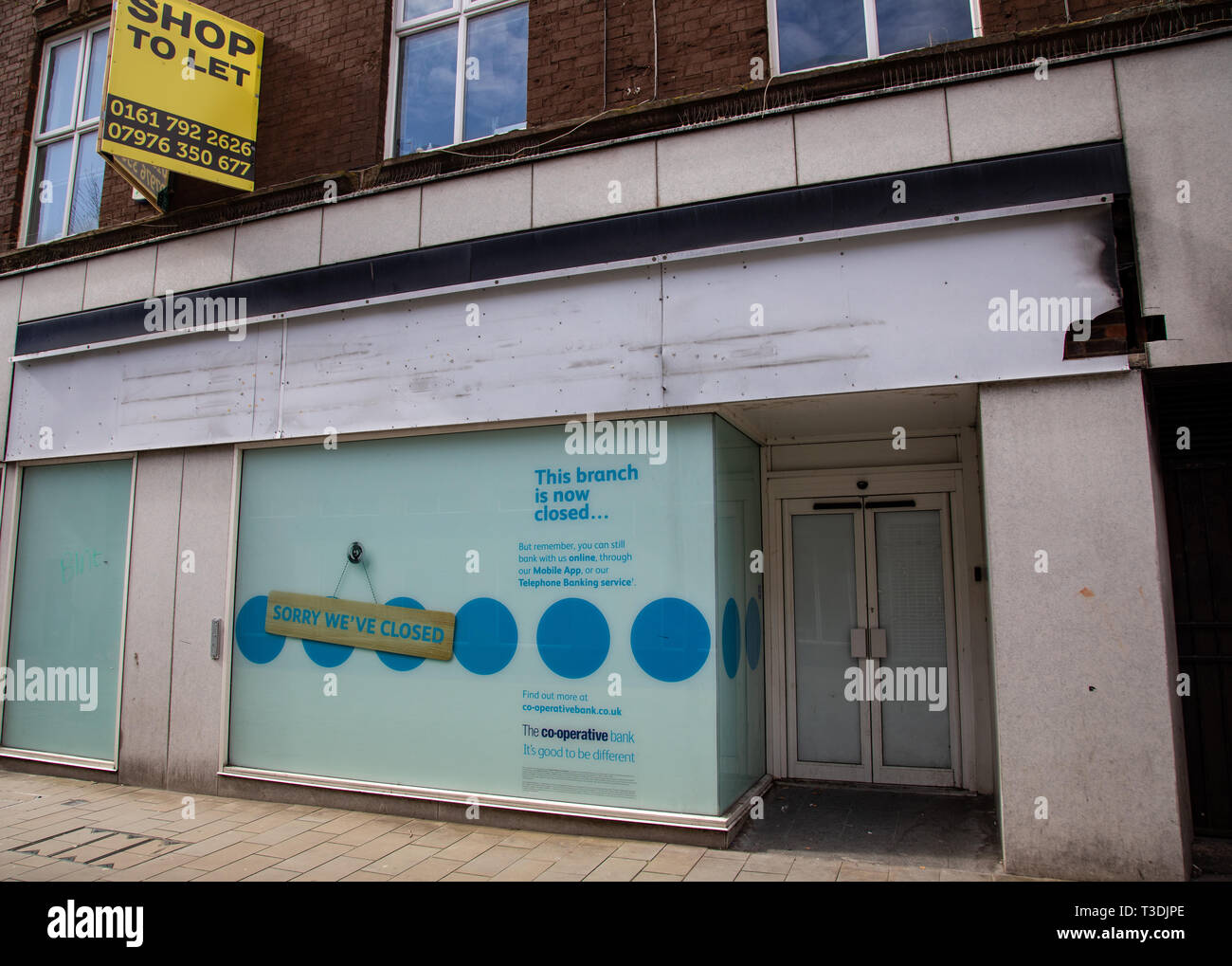 Empty retail unit for a bank on a high street St Helens Merseyside March 2019 Stock Photo