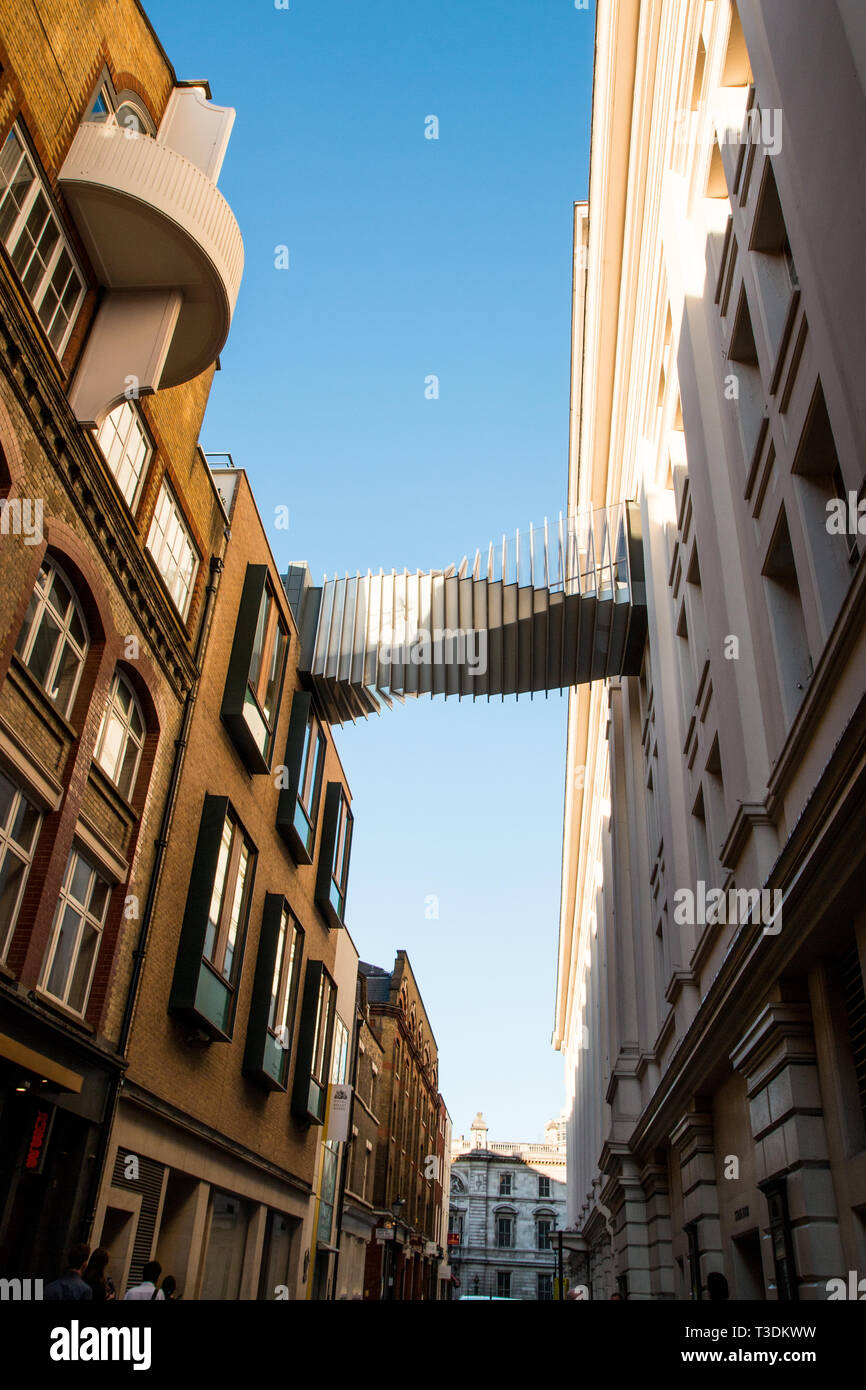 Small footbridge adding buildings central London - Stock Image