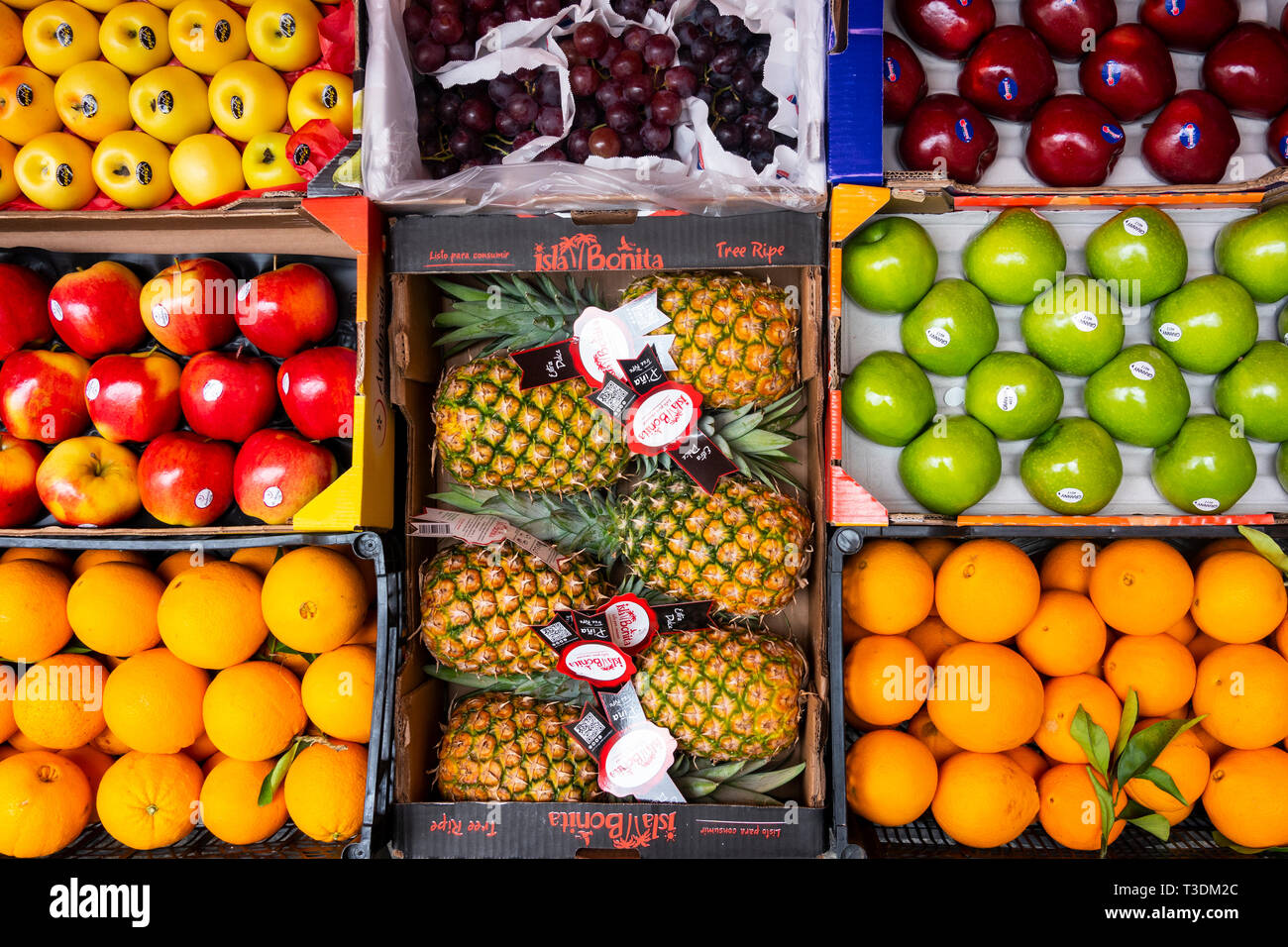Boxes of fresh fruit on sale at a market in Seville Stock Photo