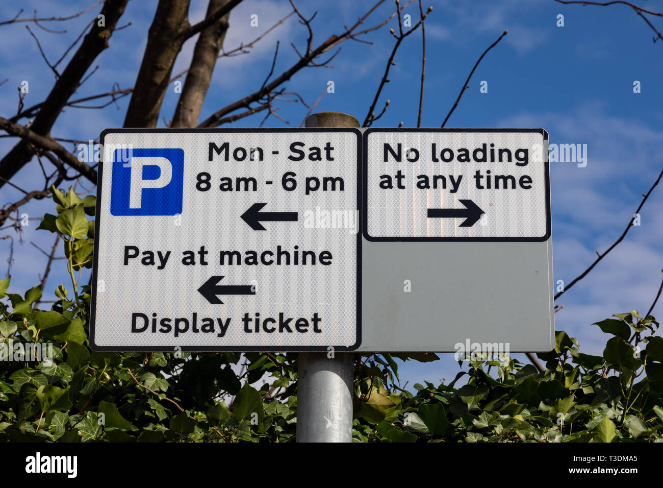 Street signs showing parking and loading restrictions St Helens Merseyside March 2019 Stock Photo