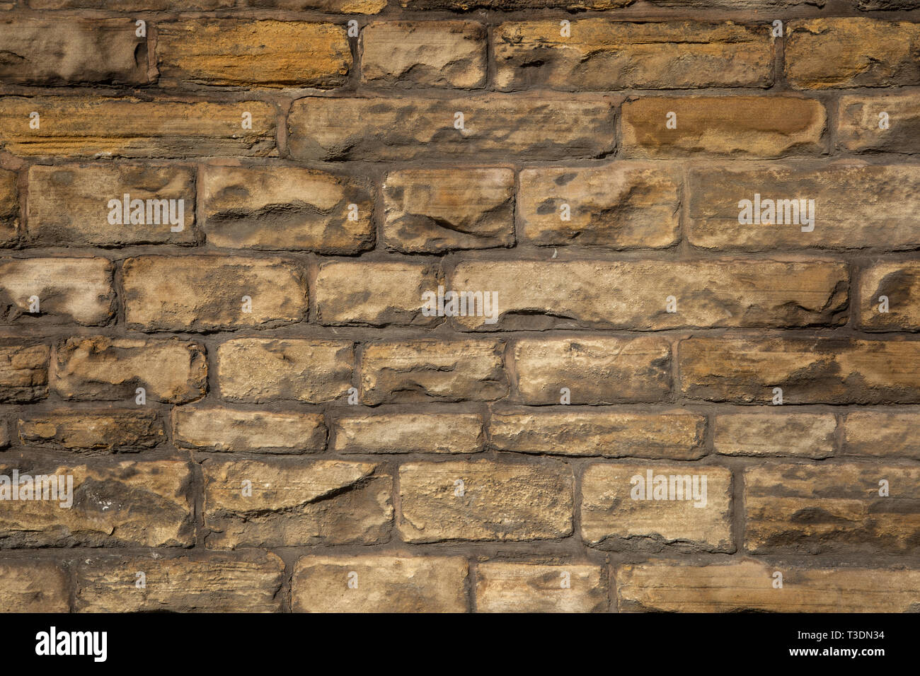 Close-up of brown brick wall with grey mortar St Helens Merseyside Lancashire March 2019 Stock Photo