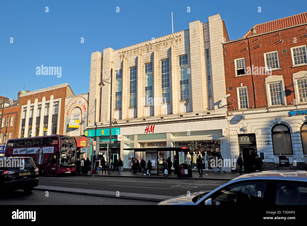 H&M store and shops on street in Brixton Hill, South London England UK Stock Photo