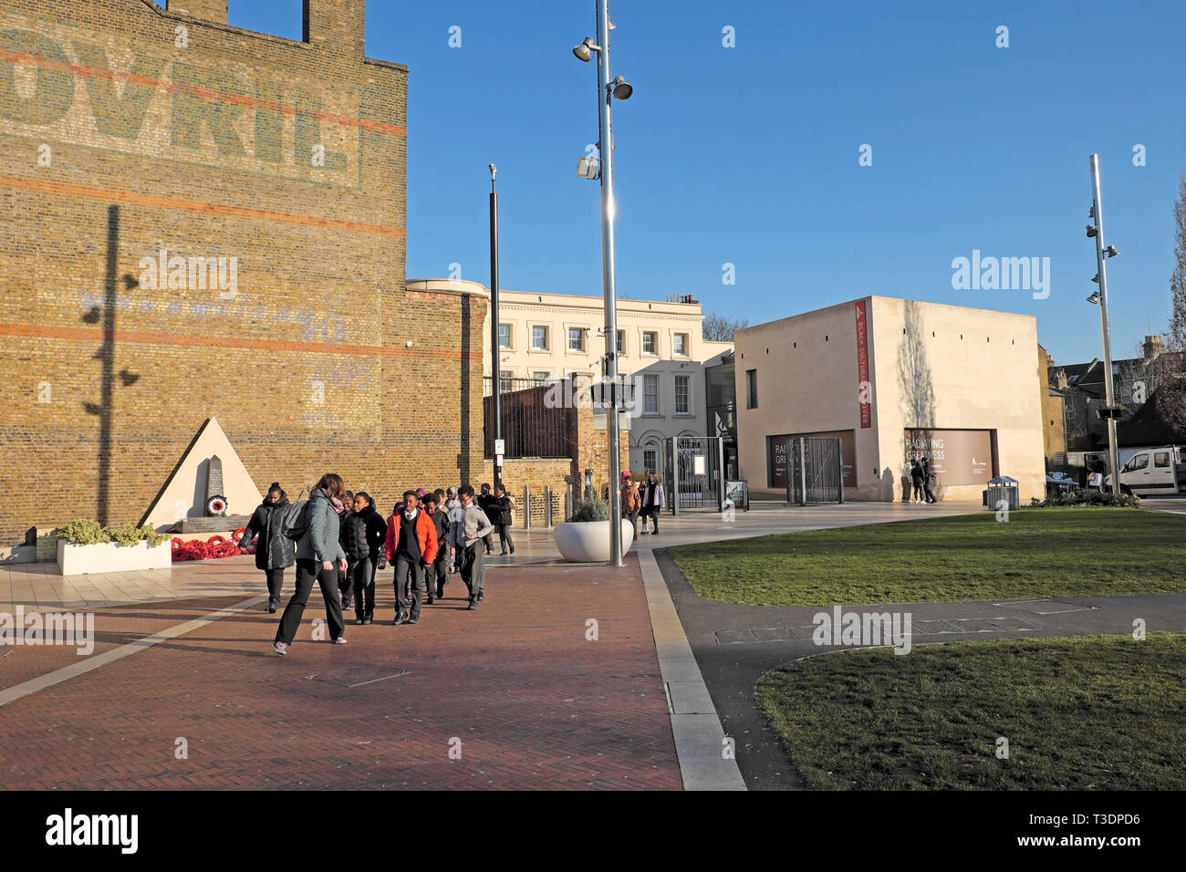 Group of schoolchildren outside the Black Cultural Archives entrance and Bovril building in Windrush Square Brixton South London SW2 UK  KATHY DEWITT Stock Photo