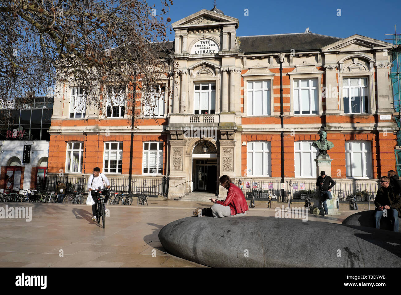 People outside the Tate Central Free Library building in Brixton South London SW2 England UK  KATHY DEWITT Stock Photo