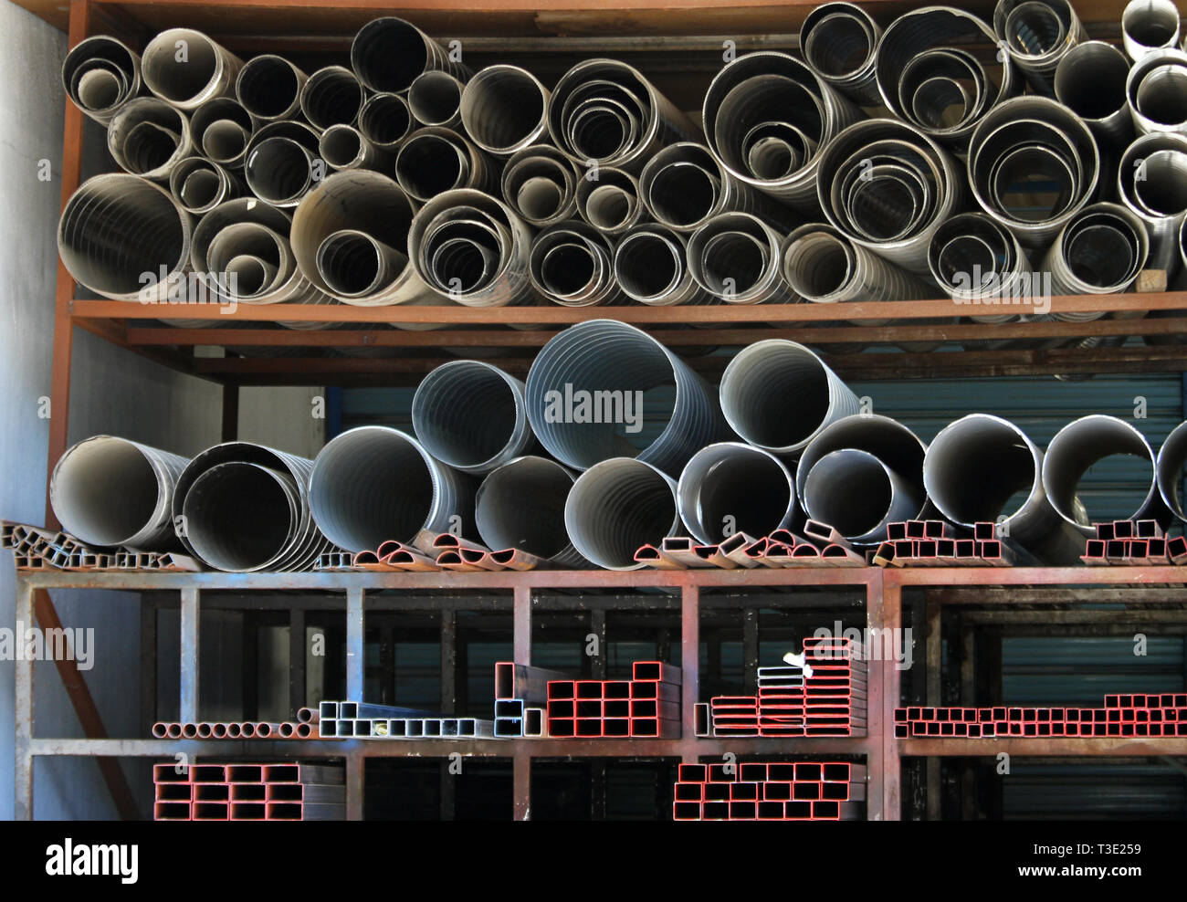 Ductile iron and zinc pipes at warehouse - Stock Image