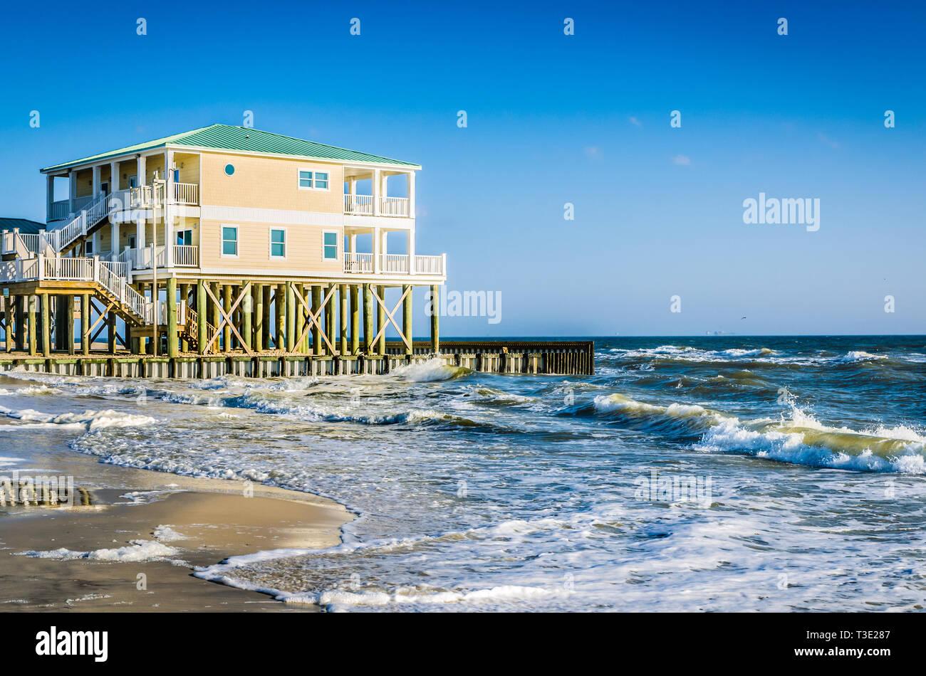 Waves crash alongside a beach house on Dauphin Island, Alabama Jan. 11, 2014. Stock Photo